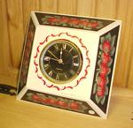 Strawberries circle this clock.  Tole painted by hand.  A cheery addition to your kitchen.  8